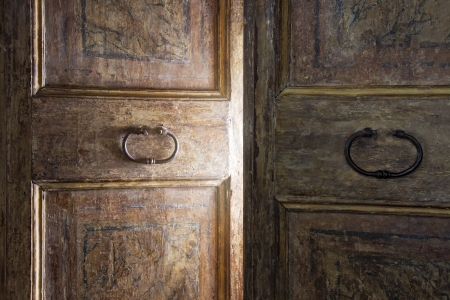 Old wooden door opening with light shining through photo