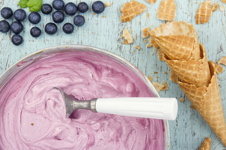 ice cream soft: Homemade blueberry ice cream on vintage light blue wooden background Stock Photo
