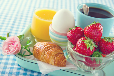 Breakfast in bed - mothers day tray with food and flowers photo