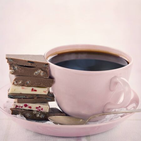 chocolate treats: Pile of chocolate and coffee in a pink cup