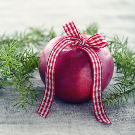 Red Christmas apple with a ribbon
