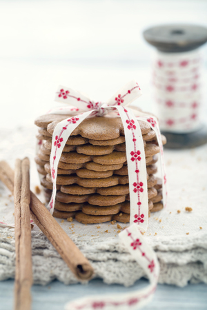 Pile of gingerbread cookies tied with a Christmas ribbon Banco de Imagens