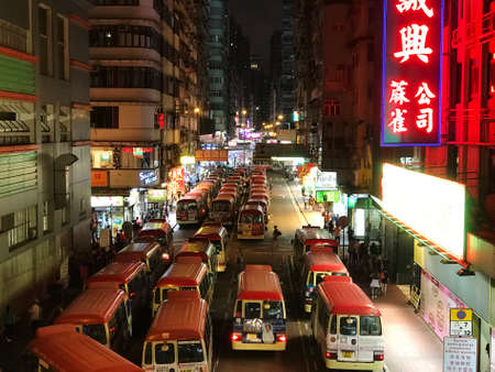 Mongkok Hong Kong, China - 19 May 2019: Red Minibuses lining up, waiting for passengers at a busy station in Mongkok, Hong Kong at night. 에디토리얼