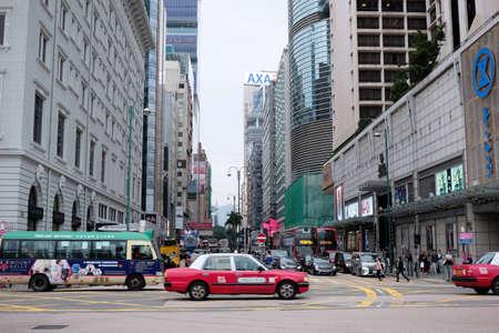 Hong Kong, China - 13 December 2018 : Street photography of people and vehicles on Nathan Road in Tsim Sha Tsui, Hong Kong