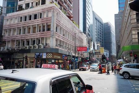 Hong Kong, China - 27 April 2020 : Street photography of people and vehicles on Tsim Sha Tsui, Hong Kong, a center of various shopping places and famous landmark of HongKong. 新闻类图片