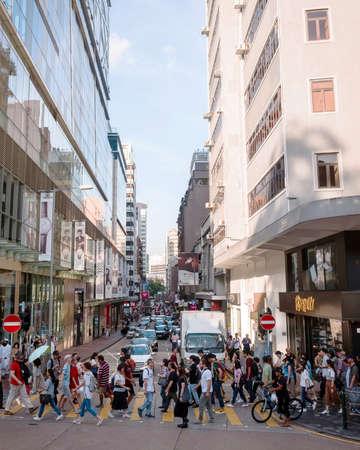 26 July 2018 - Tsim Sha Tsui, Hong Kong : People on busy street in Tsim Sha Tsui, a center of various shopping places and famous landmark of HongKong.
