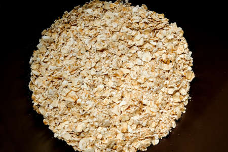 rolled oat, oat flakes photo, oat background. Banco de Imagens - 158734240