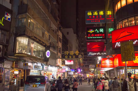 Tsim Sha Tsui, Hong Kong - 09 February 2018: Neon lights on Tsim Sha Tsui street in Hong Kong. Tsim Sha Tsui street is a very popular shopping place in Hong Kong.