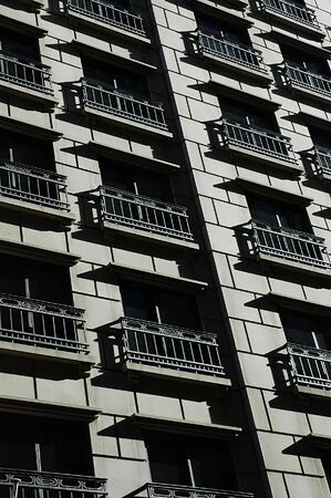 kaleidascope: building facade and balcony with sunset shadow Stock Photo