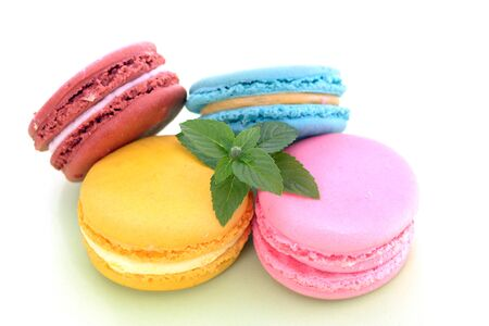 Four macaroon cakes on white background