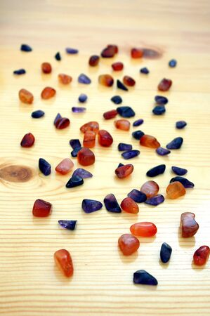 Colorful stones on wooden table