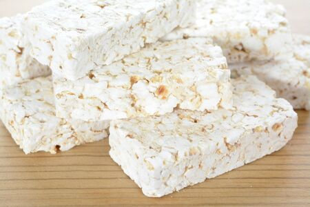 A group rice craker bars on wooden table
