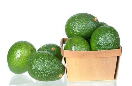 A group Organic avocado in in bucket on white Imagens