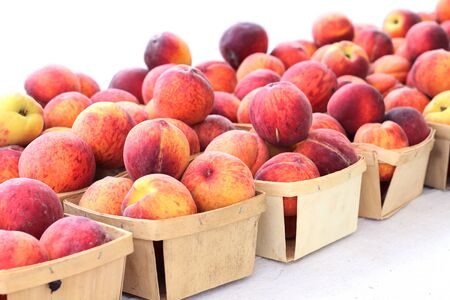peach in crate at market place