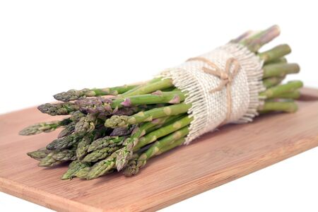 asparagus bunch on the cutting board Stock Photo