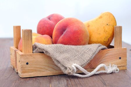 peach and mango on the wooden table