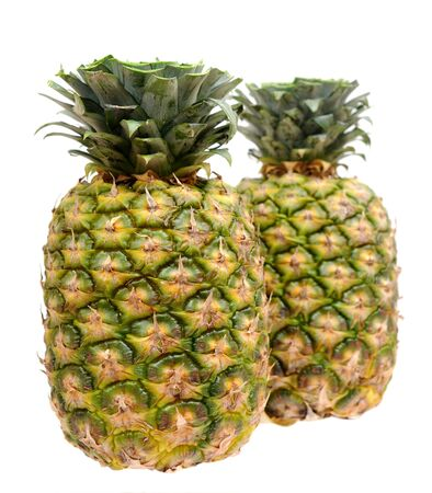 two fresh and juicy pineapples isolated on white background