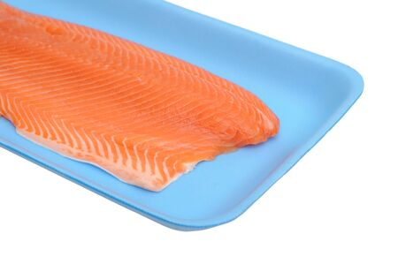 filleted salmon on tray isolated on white background