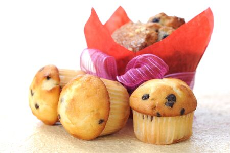 big and three mini muffins on table