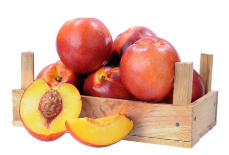 a group of nectarine in crate isolated on white 写真素材