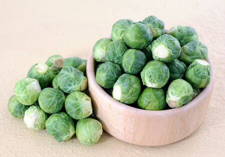 Brussels sprouts in wooden bowl on the table Reklamní fotografie