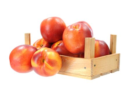 nectarine in crate isolated on white