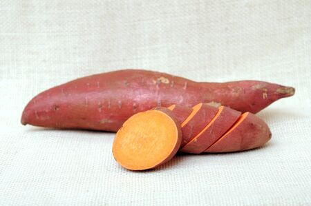 sweet potatoes on burlap background