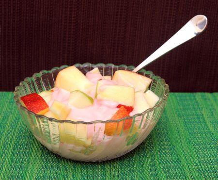 Apple fruit slice and yogurt in bowl