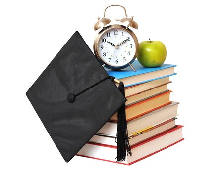 many books , clock, apple and graduated cap