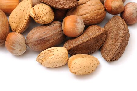 some kinds of nuts on white
