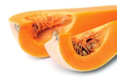 closeup butternut squash sections on white background