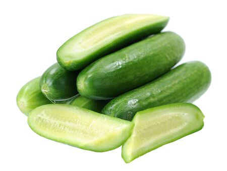 chopped cucumber isolated on white