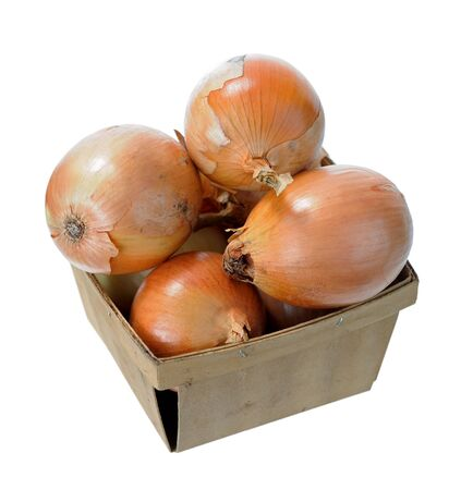 a lot of onion bulbs in wooden bucket isolated on white