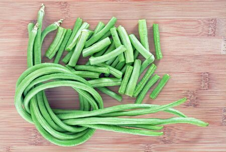 green fresh long beans on cutting board