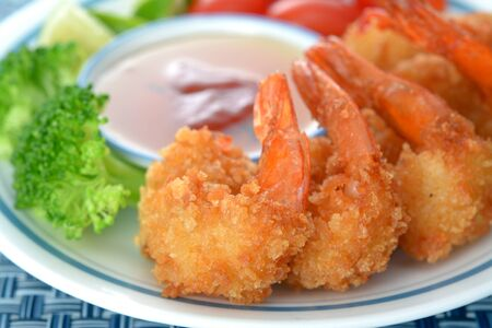 coconut shrimp with sauce and vegetable in plate