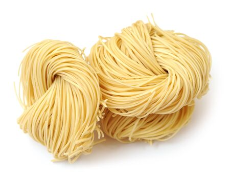 three bunches of nested  noodle on white background