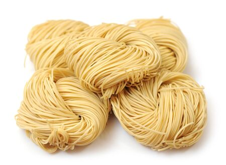 bunches of dried noodle on white background