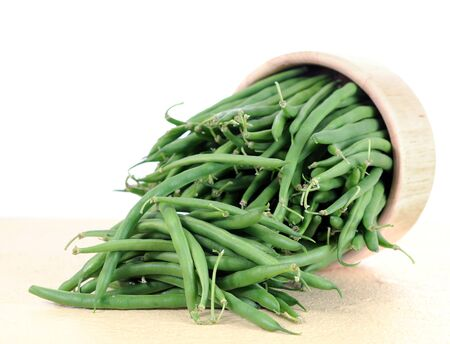 green beans on table against white background