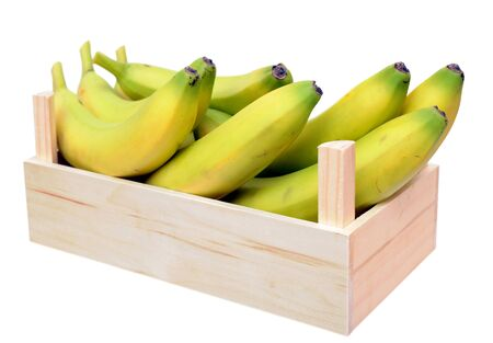 young ripe banana in crate isolated on white