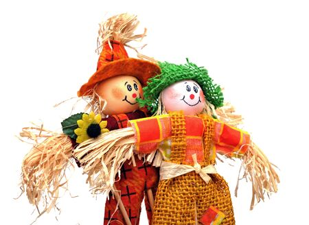 a pair of scarecrows on white background