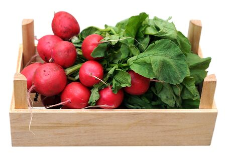 bunches of organic radish on wooden crate