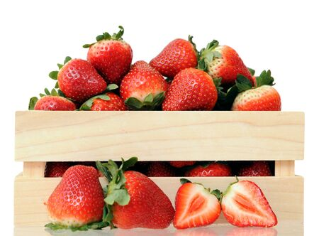 a crate of strawberries on white