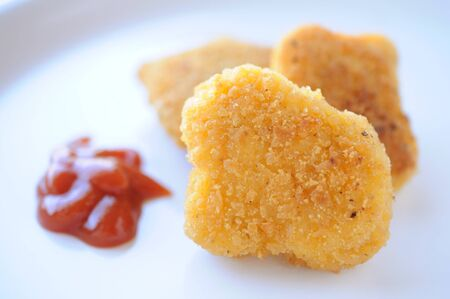 chicken nugget and ketchup on dish Archivio Fotografico