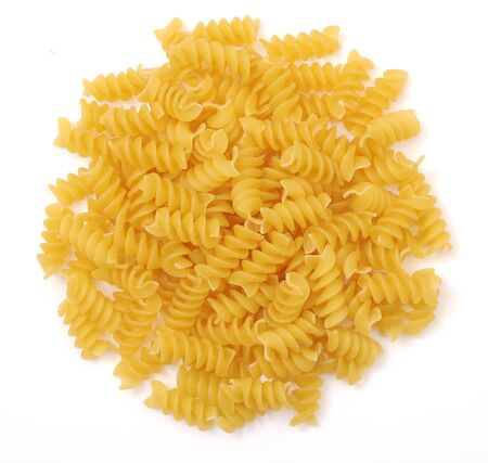 a pile of spiral pasta on white background