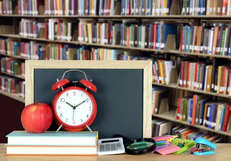 colorful books and bookshelf for education concept Stock Photo
