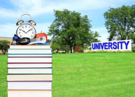 book and campus of university (very blurried and compsited back ground)