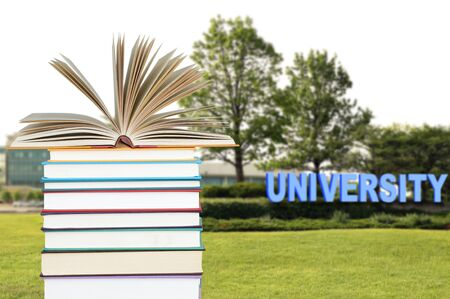 book and university campus (very blurred and composed background)