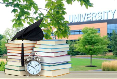 composition of education concept with university campus and books