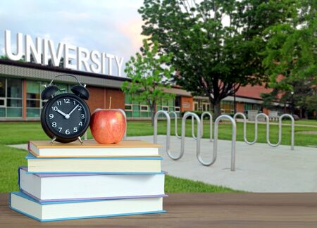 An Education Concept with books and Campus of University Banco de Imagens
