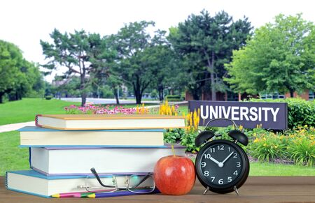 An education concept with university campus and book
